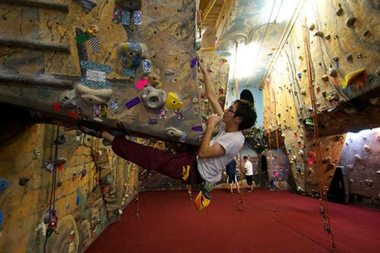a rock climber reaching up