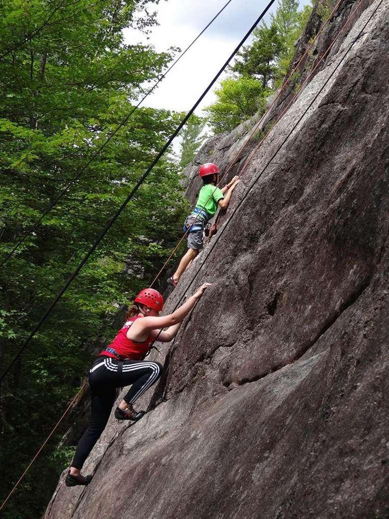 two people climbing outdoors