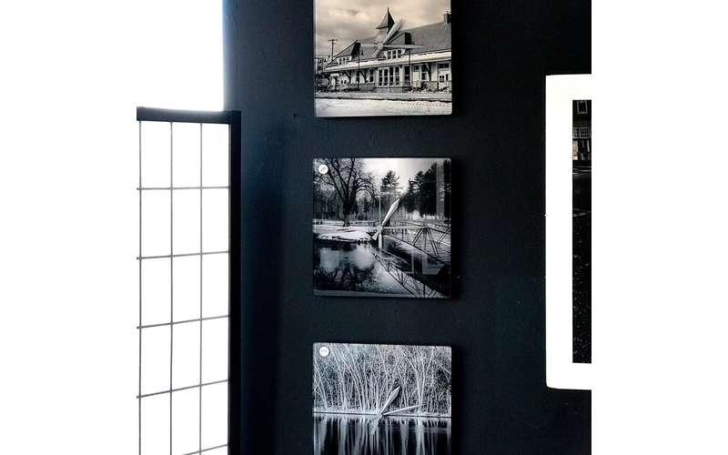 a few artworks hanging from a wall