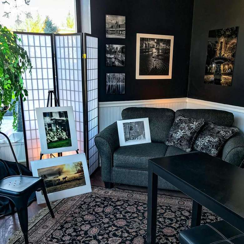 artworks on display around a couch