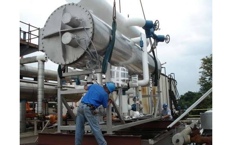 man installing a spray chiller