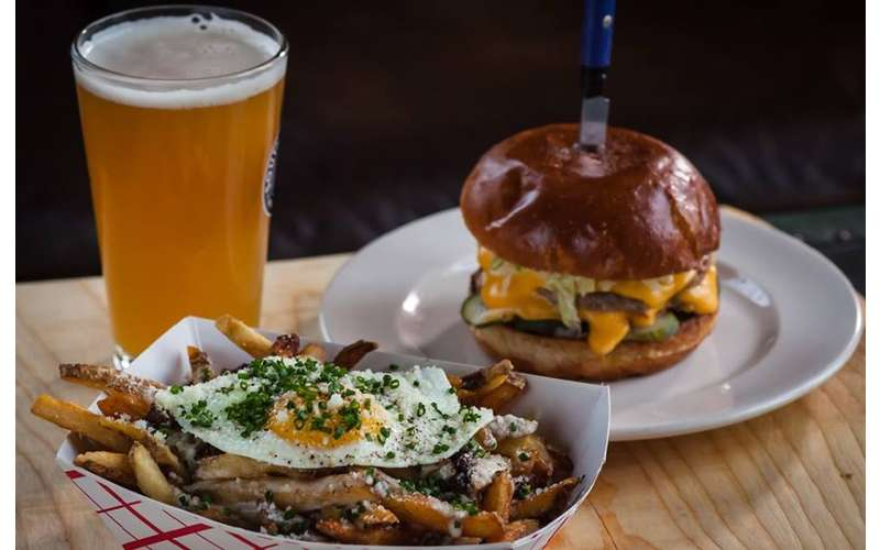 a burger, glass of beer, and fries