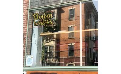 restaurant window with the words berben and wolff's