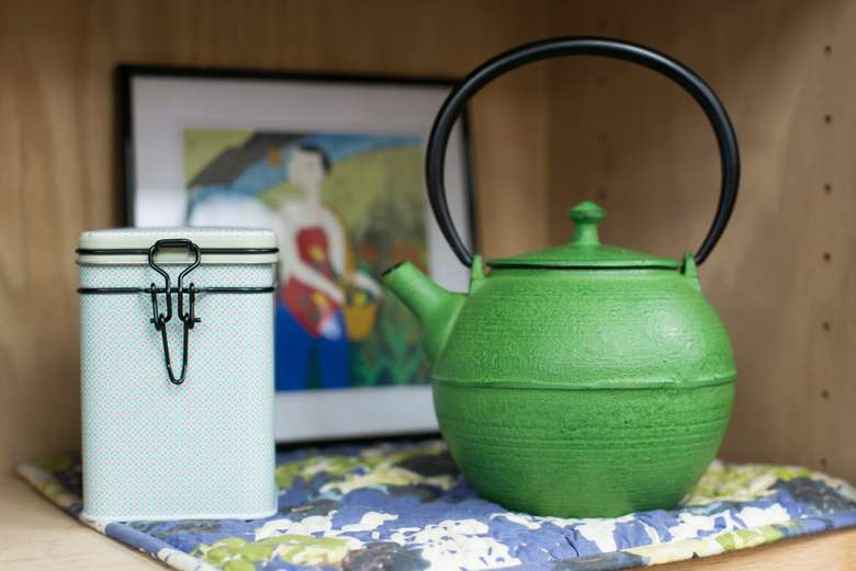 green teapot with a white canister next to it