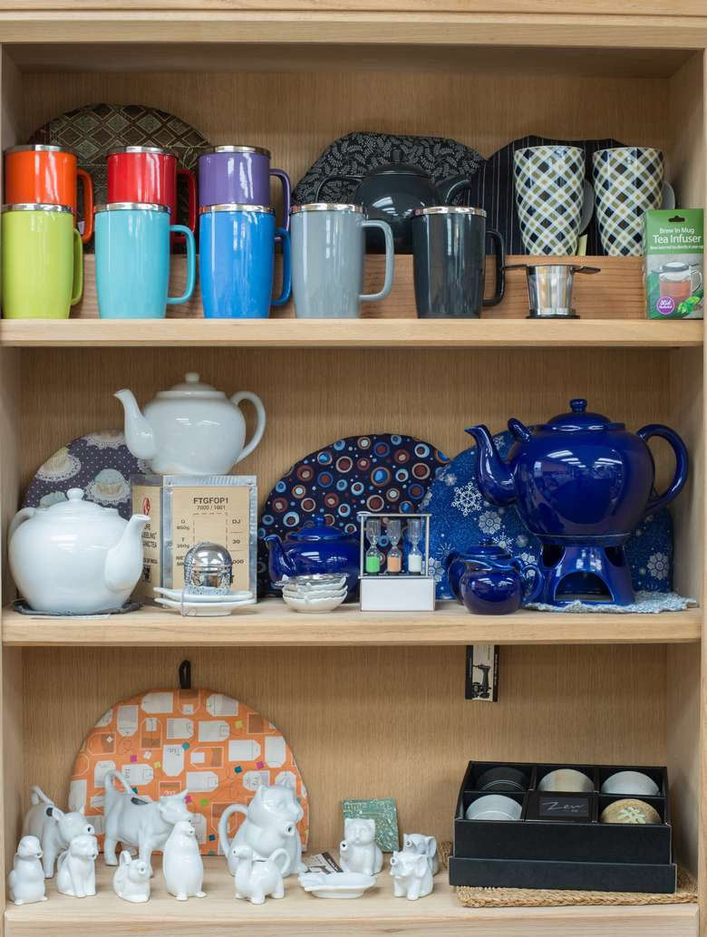 shelves full of mugs, cups, and teapots