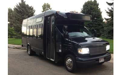 the exterior of a black party bus
