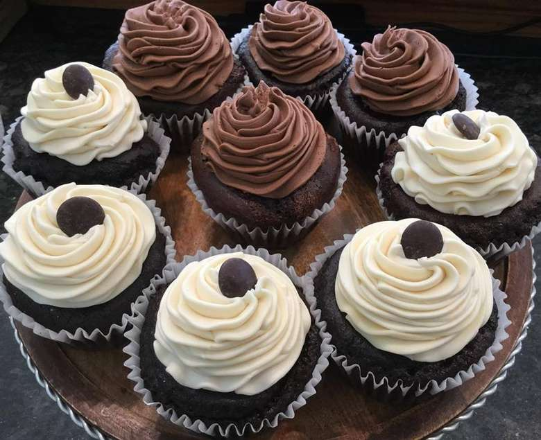 chocolate cupcakes, some with chocolate frosting, some with vanilla