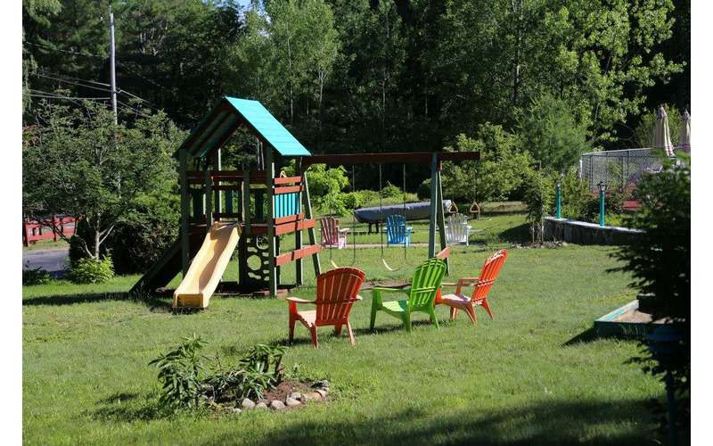 a playground and lawn chairs