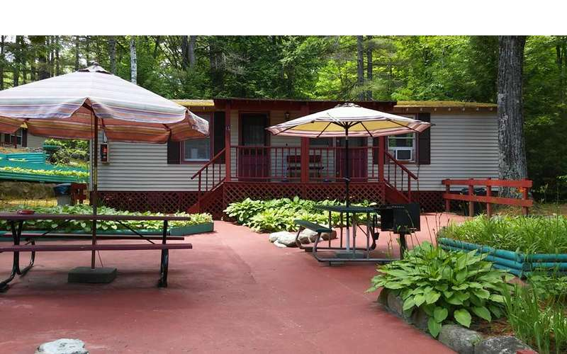 picnic tables in front of cottages