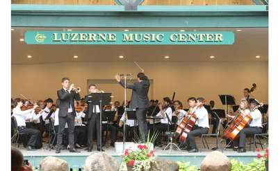 a concert being performed under Luzerne Music Center sign