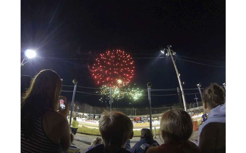 people watching fireworks over racetrack