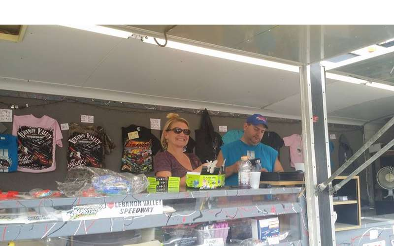 man and woman behind a vendor stand