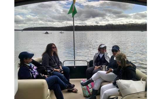 Group of women relaxing on Adirondack Cruise & Charter boat with view of Saratoga Lake