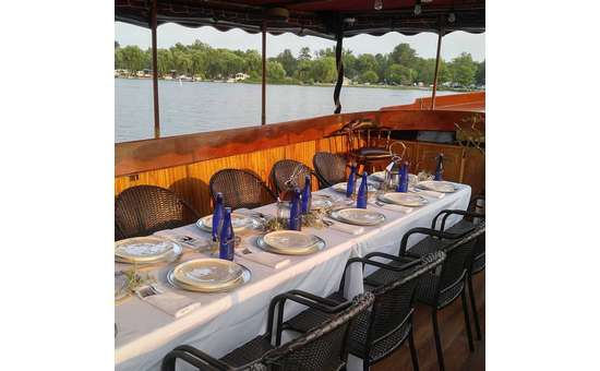 elegant dinner set up for a Dinner Cruise on an Adirondack Cruise & Charter boat