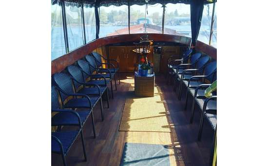inside of Adirondack Cruise & Charter boat with chairs