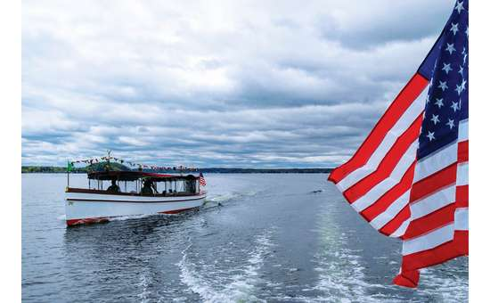 Adirondack Cruise on Saratoga lake with the American flag on the side