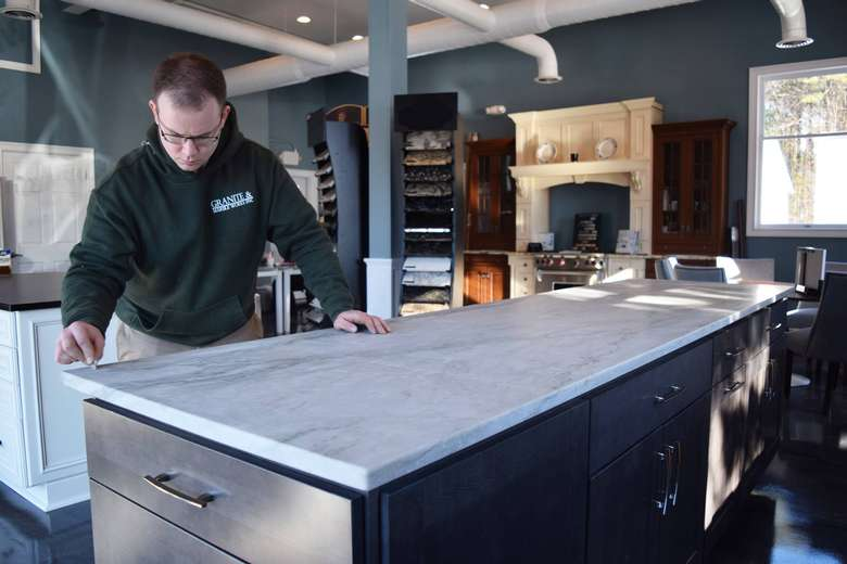 employee working on new marble countertop
