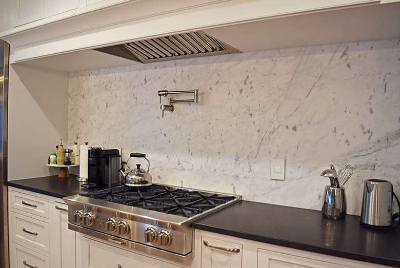 kitchen countertop with marble wall