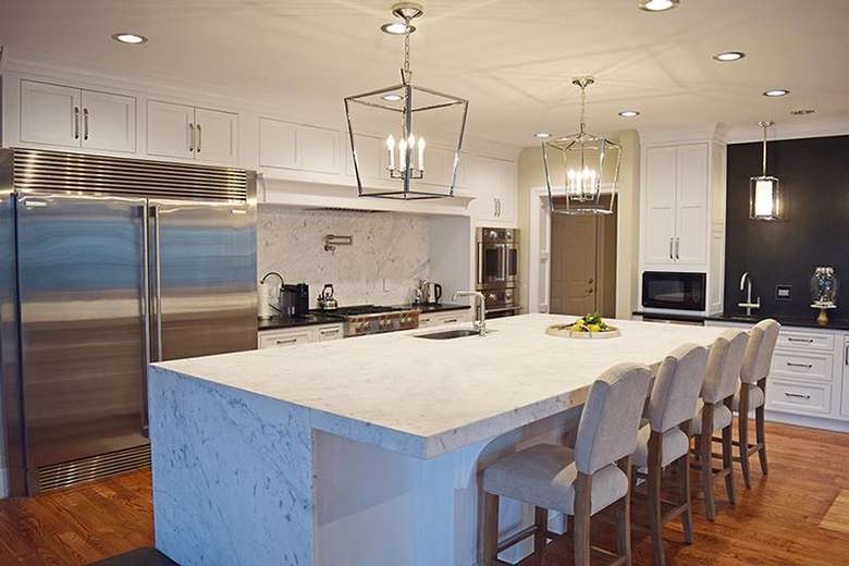 kitchen marble countertop with fridge and chairs
