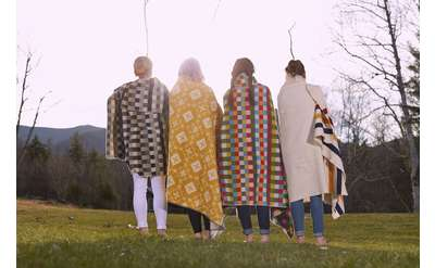 four girls with blankets