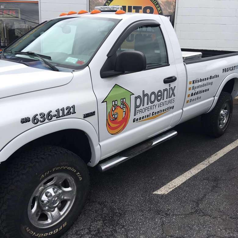 a white truck with Phoenix Property Ventures logo