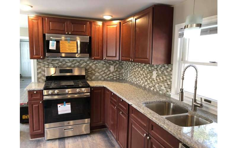 kitchen cabinets and oven and appliances