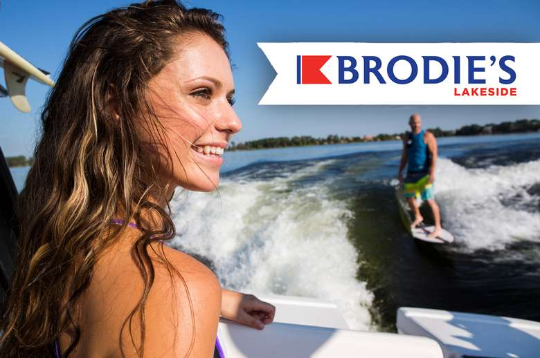 photo of a woman on a boat with the brodie's lakeside logo