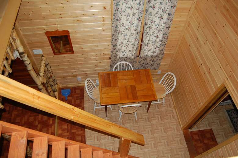 photo of stairwell and kitchen in Adirondack Beach House