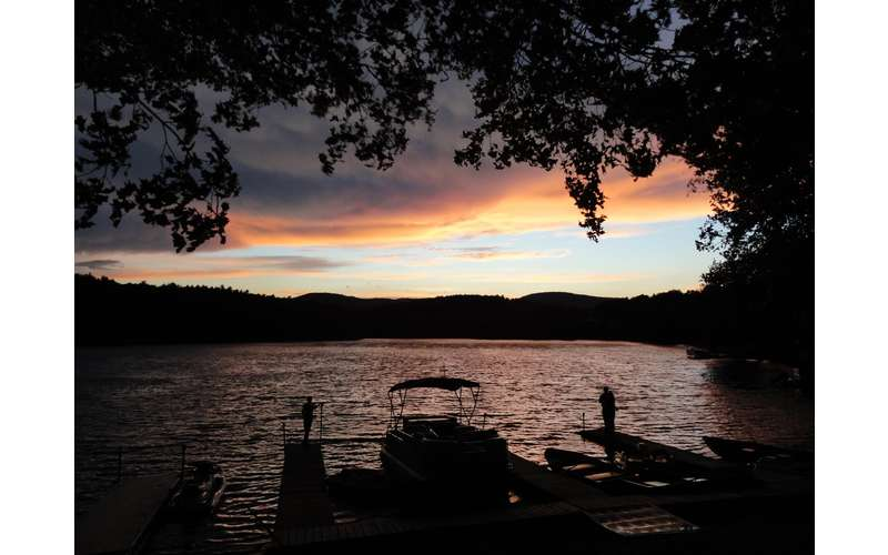 Sacandaga Lodge dock and river during the sunset