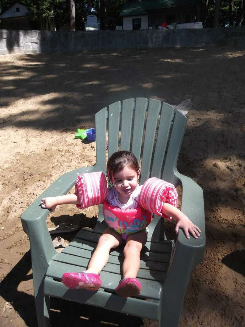 little girl in Adirondack chair.