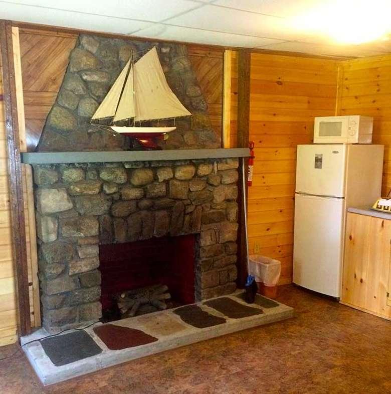 fireplace inside Sacandaga Lodge