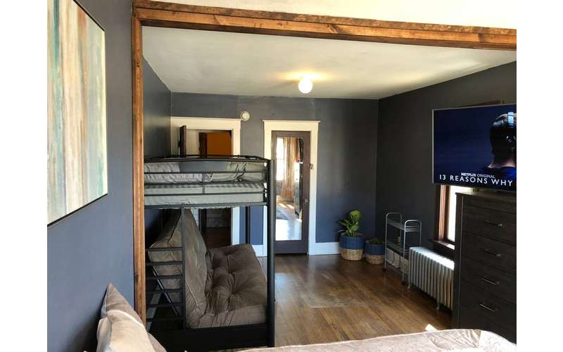 photo of bedroom with bunkbeds & TV