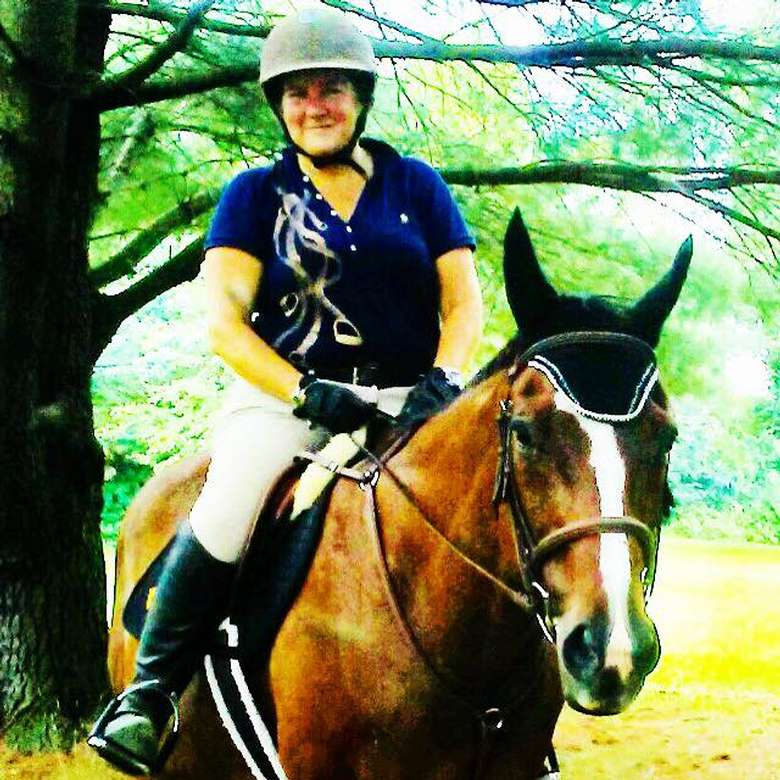 Riding Instructor Whitney Mulqueen on Wesley at Glenham Farm cooling off after a hack through the pines