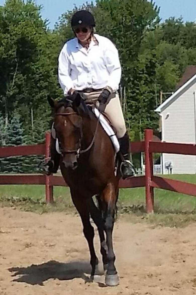 Riding Instructor Whitney Mulqueen schooling client's horse at a Pennsylvania Horse Show