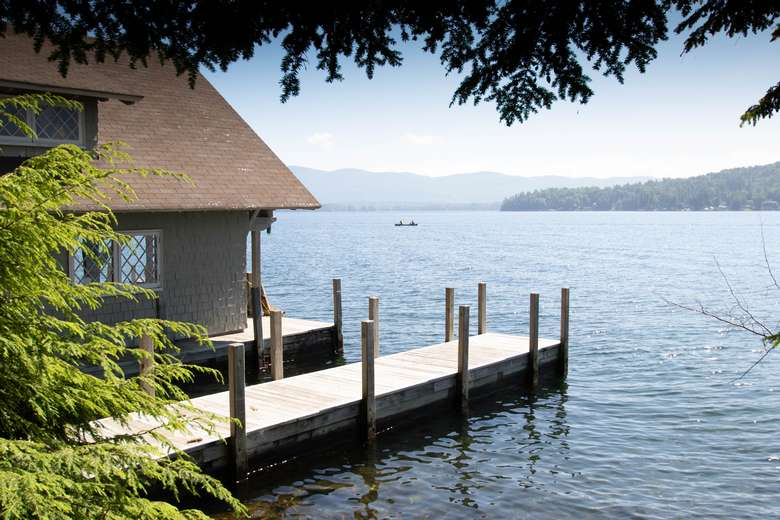 Exterior shot of docks available - bring your boat to explore Lake George by boat.  The property accommodates 3 boats
