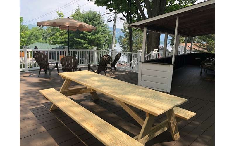 deck space with dining and picnic table