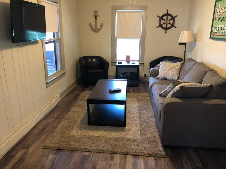 photo of living room in cabin with furniture
