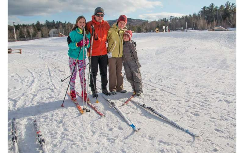 four people on cross country skis