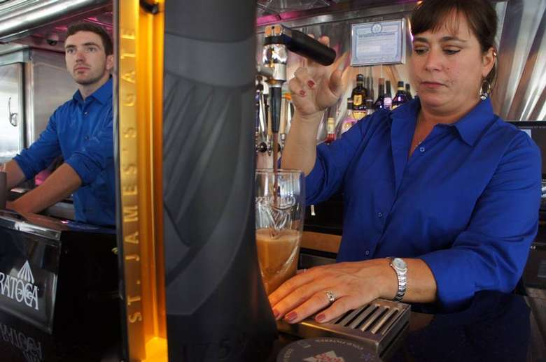 two Dunning Street Station employees working at the bar