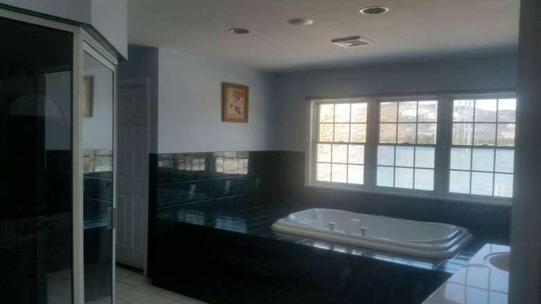 a bathroom with a jacuzzi tub