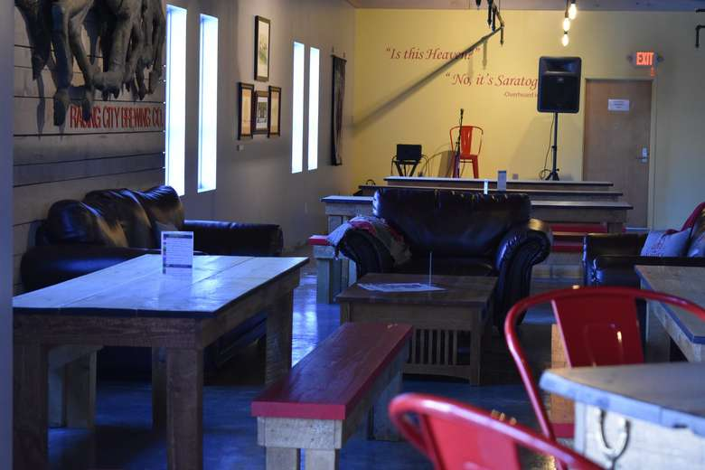 comfortable chairs and tables with Racing City Brewing Co.'s stage for live music events