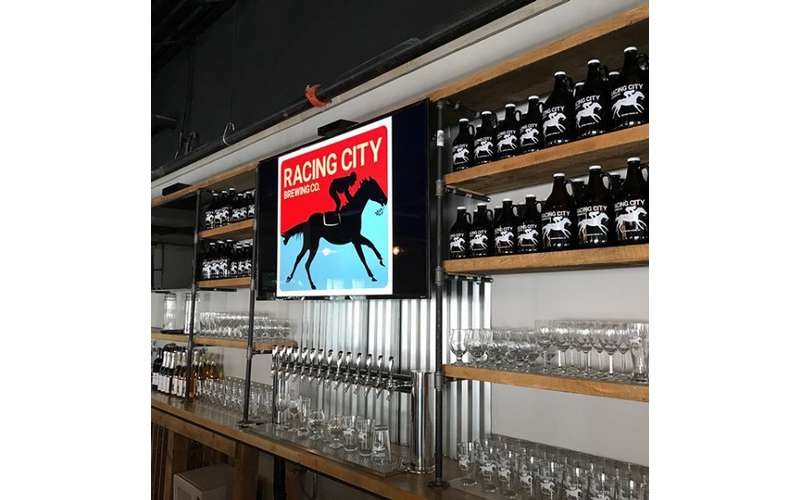 Racing City Brewing Co. bar with bottles of beer