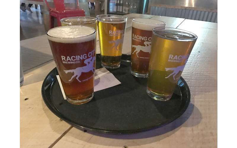 table with five beers from Racing City Brewing Co.