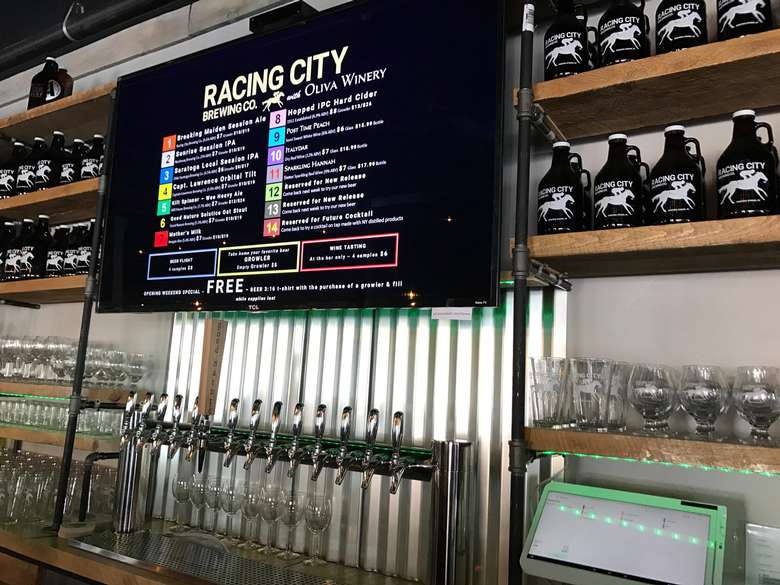 Racing City Brewing Co. bar with glasses, tap, and drink menu
