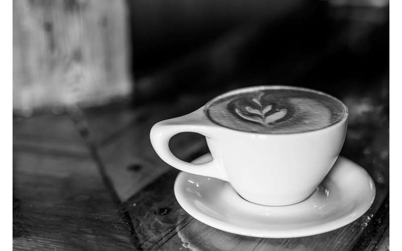 black and white photo of coffee in a cup