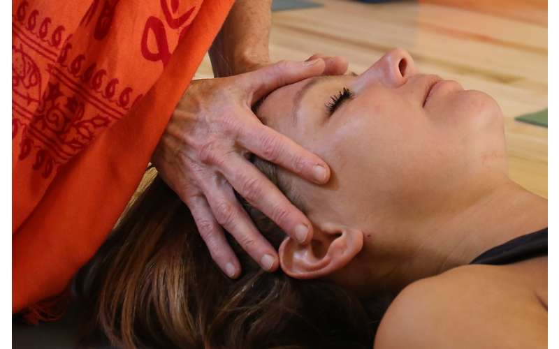 a woman getting a facial massage
