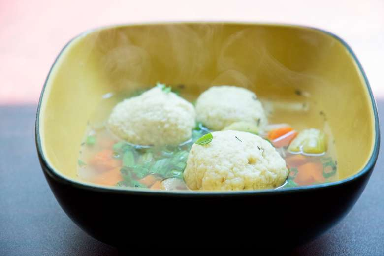 steaming matzo ball soup