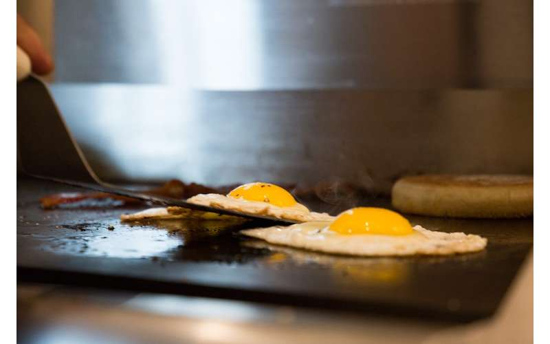 eggs flipped on a griddle