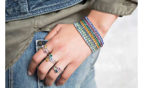 hand over pocket with rings and bracelets