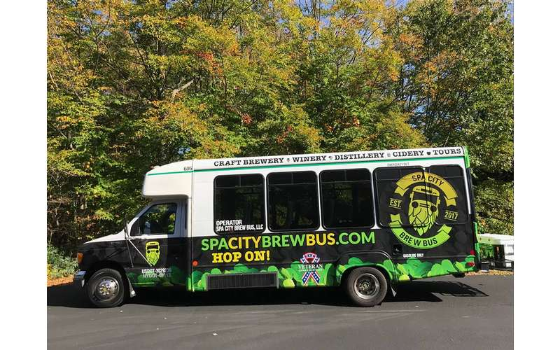 the side of the spa city brew bus